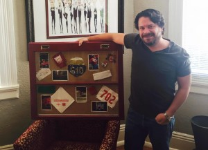 Kiley standing with one of his custom works of art!